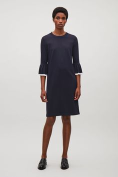 COS image 6 of Knitted dress with pleated sleeves    in Navy
