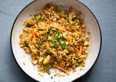 bon appetit // Sriracha Fried Rice:  Sauté some ginger, garlic, and scallions with leftover rice. Stir in beaten egg. Season with Sriracha and soy sauce to taste.