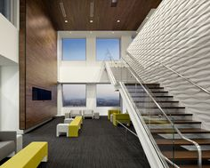 Design-build renovation for a Silicon Valley software company to create a collaborative, open work environment. A new architectural staircase was craned into the high-rise building through a window and then set in place. Highlighted by a modularArts feature wall, the modern wood, glass and steel stair tops off at an executive boardroom.