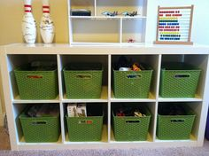 IKEA shelving - target bins. Could work in the building. Different green though