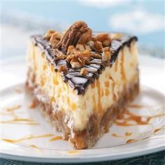 Layered Turtle Cheesecake Recipe -After receiving a request for a special turtle cheesecake and not finding a good recipe, I created my own. Everyone is thrilled with the results and this cheesecake remains a favorite at the coffee shop where I work. —Sue Gronholz, Beaver Dam, Wisconsin