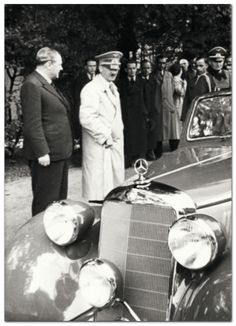 Great photo of Hitler examining a Mercedes in 1939 with Jakob Werlin, a high executive with Mercedes. We know Hitler never had this auto because it is not black. His Mercedes cars were all black after 1926.