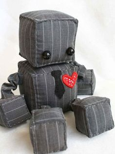 Adorable robot plushies! Look at the cute little tie! And there are more! (etsy Littlebrownbyrd via Buzzfeed)