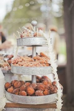 have handmade donuts for guests in a galvanized metal display