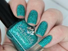 Emily de Molly - Folklore | February 27, 2014 | Turquoise holographic micro glitter in lightly tinted turquoise jelly