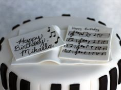Top your cake with your music sheet decorations.  Photo by Jennifer Melo