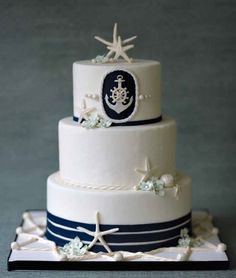 Nautical Wedding Cake. Lie the starfish on it but not the navy blue. Probably gold