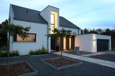 Eingangsbereich Nachtaufnahme: minimalistische Häuser von Architektur Jansen