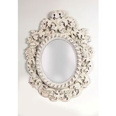 Whitehall distressed cream ornate oval shaped mirror. The reflective surface of mirror size is 40cm x 50cm, overall size 75cm x100cm. 3mm plain mirror complete with ready fitted hangers  for hanging, and instruction leaflet.