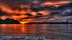 Download Wallpaper 1920x1080 Sea, Mountains, Sky, Light, Sunset Full HD 1080p HD Background