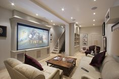 CEDIA Award Runner Up Best Media Room under £15k traditional media room.  The screen rolls down in front of bookcases to convert to a home theater.