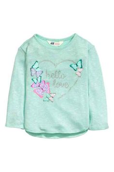 Knitted jumper with a motif: Long-sleeved jumper in a soft, fine knit with a print motif on the front and a gently rounded hem. Kids Outfits Girls, Toddler Girl Outfits, Girls Tees, Shirts For Girls, Baby Girl Fashion, Kids Fashion, Sewing Baby Clothes, Butterfly Kids, Girl Trends