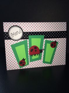 """Card using Walk In My Garden Cricut Cartridge. Grass blades (3), pg 58, were cut at 3"""". Lg ladybug, pg 68, was cut at 1"""". Sm ladybugs, pg 69, were cut at .75"""". The A2 card base is from a set of Recollection cards and envelopes from Michaels. Created by: Melanie Weise"""