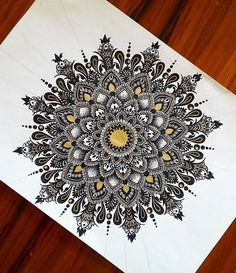 This mandala has a 3D appearance.