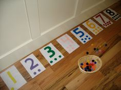 Montessori activity: felt numbers and matching color poms... my two year old is obsessed!