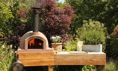 Love the thought of having one of these in the garden. Primo | Wood Burning Pizza Oven | The Stone Bake Oven Company
