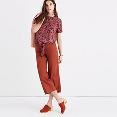 """A tie-front top with buttons all the way down the back for your basic """"party in front, party in back"""" situation. In a pretty woodcut-inspired print, this shirt is an office-friendly option as easy to toss on as a tee. <ul><li>True to size.</li><li>Silk.</li><li>Dry clean.</li><li>Import.</li></ul>"""