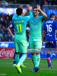 Luis Suarez (R) of FC Barcelona celebrates scoring their sixth goal with teammate Neymar JR. (L) during the La Liga match between Deportivo Alaves and FC Barcelona at Estadio de Mendizorroza on February 11, 2017 in Vitoria-Gasteiz, Spain.