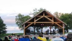 Places To See in Winnipeg Beach Manitoba - Attractions Landmarks & Outdoor Activities Outdoor Stage, Outdoor Theater, Cottage In The Woods, Wood Cottage, Community Space, Stage Design, Outdoor Activities, Botanical Gardens, Places To See