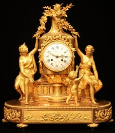 Louis XVI Ormolu Mantel Clock With Movement By  Lepine, Depicting Two Scantily Clad Women Seated On Either Side Of A Large Flower-Filled Vase On A Pedestal, Both Reaching Up To Touch The Flowers - France   c. Louis XVI Period