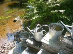 Watering can fountain.