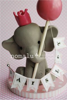 Princess Paisley    This sweet little princess elephant is ready to announce your childs next birthday with a pretty little tiara and a festive balloon,
