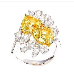 Prima Gems One of our Fancy Yellow Diamond Collection: 2.25 + 2.51ct Fancy Intense Yellow Heart Shape Diamond Ring with Fancy White Diamond.