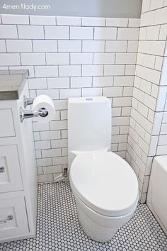 White Tile Bathroom Gray Grout white penny tile with dark gray grout - would love this for my
