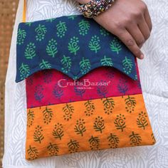 Sanganeri Bock Prints in Blue, Crimson and Yellow with an elegant flap. Wash and wear at its best! #craftsofindia #indianhandicrafts #madeinindia #craftsbazaar #artsandcrafts #handmade