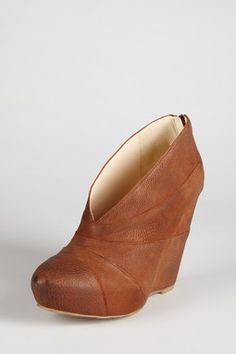 *sad face* these make me miss my pair almost exactly like these only with a stiletto heel and in black v_v,  *sigh, tear* Boutique 9 Wedge Bootie