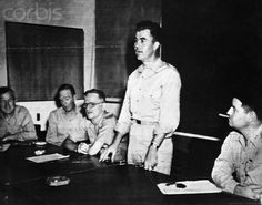 , of Miami, Fla. (standing) pilot of the Superfortress which dropped the first atomic bomb on Hiroshima, tells of his experience at a press conference at U. Army Strategic Air Force Headquarters at Guam. First Atomic Bomb, Enola Gay, Manhattan Project, Rich Image, Music Licensing, Atomic Age, Chief Of Staff, Great Leaders, Hiroshima