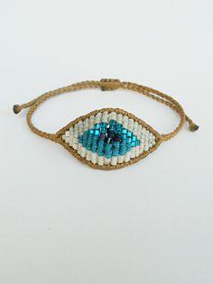 Evil eye beaded braceletSacred by LuckyRatJewellery on Etsy