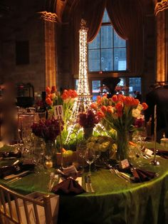 Love the Eiffel Tower centerpiece for the Paris table. Would be beautiful to do a table for each place the couple plans to travel. Thema Paris, Eiffel Tower Centerpiece, Parisian Party, Springtime In Paris, Dinner Party Invitations, Paris Wedding, Dream Wedding, Purple Wedding, Gold Wedding