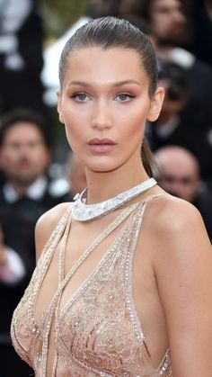 Bella Hadid looks stunning in this simple bronzed makeup look with matte nude lips and a sleek ponytail.