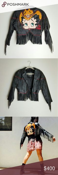 Vintage Betty Boop leather embellished fringed jac Dying here: amazing vintage find ???  Dope Betty Boop 80's real leather fringed moto biker jacket by Maziar Leather Gallery, size Small.  More than a vintage treasure, this is literally a piece of art: hand made embellisments in each fringe and big arse color pop sassy Betty at back.  This is an statement one of a kind piece. I haven't seen anything like it before... and probably never will.  In good vintage condition. Leather shows minimal…