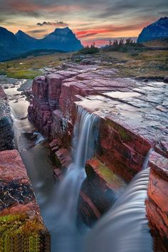 Border of Montana USA and Alberta, Canada) - PIC of the Day : Beautiful waterfall in Glacier National Park , US  Glacier National Park is a national park located in the U.S. state of Montana, on the Canada – United States border with the Canadian provinces of Alberta and British Columbia.  For more travel Updates/Offers and Interesting Stuffs be connected to  Travel Universally