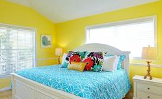 Let the sunshine in! Bright yellow bedroom in a beach cottage, featured here: http://beachblissliving.com/beach-decorating-with-tropical-colors/