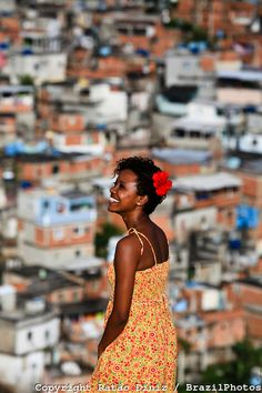 Brazilian woman with Favela in the background
