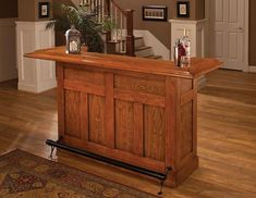 Hillsdale Furniture large cherry bar goes great in any basement, den, or home bar. The built in wine rack holds up to 12 bottles of your favorite wine or liquor. Storage cabinets provide additional space for bar supplies. This large bar is constructed of Wooden Home Bar, Small Bars For Home, Home Bar Cabinet, Cherry Bars, Cherry Red, Wine Bottle Storage, Wine Racks, Game Room Bar, Home Bar Furniture