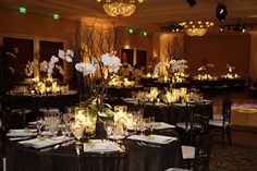 tall centerpiece with lots of candles around