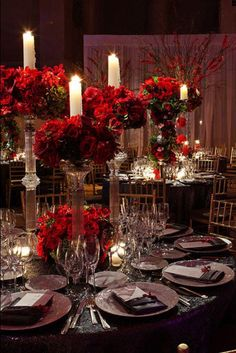 Romantic red roses on dark-hued tableclothes, illuminated by candlelight. Photo Credit: Fred Marcus Studio/Created by: Tantawan Bloom
