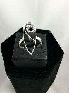 A personal favorite from my Etsy shop https://www.etsy.com/listing/448698724/swirls-ring-size-11