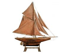 ANTIQUE BOAT MODEL WITH STAND  WINNING BID $1351.00