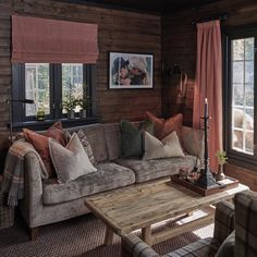 Image may contain: 1 person, sitting, living room, table and indoor Gray Interior, Interior Design Living Room, Cabin Design, House Design, Cottage Interiors, My Living Room, Log Homes, Family Room, Decoration