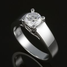 Classic diamond solitaire with cross over prongs and tapered flat band shoulders. A diamond ring that's comfortable on your hand, with a lots of sizzle.