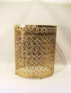 For the powder room.  Vintage Hollywood Regency Gold Filigree Waste by Lifeinmommatone, $40.00