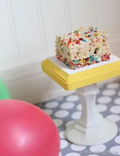 Rice Crispy Treats with Sprinkles and Fruity Pebbles at the bottom