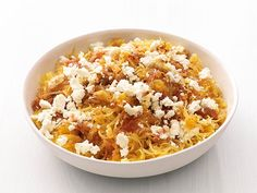 Spaghetti Squash with Feta : It's a vegetable — and a pasta! Strands of spaghetti squash make a noodle-like base for a simple sauce and some crumbled feta.
