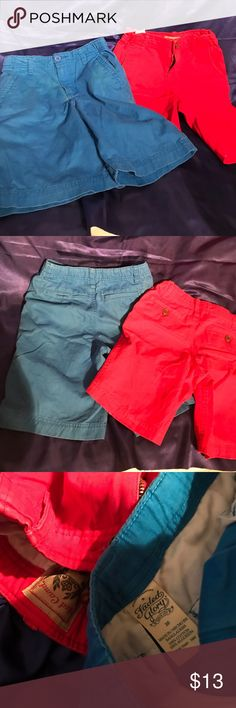 Youth boys colored khaki shorts size 10 Both size 10. Red shorts are by Red Camel and blue shorts are by Faded Glory.               C819 Red Camel Bottoms Shorts