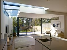 Roundhouse bespoke Urbo kitchen in extension. And love the ceiling lights too.